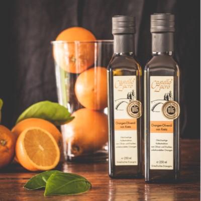 Orangen Olivenöl auf dem Tisch serviert